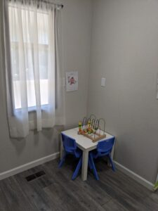 picture of table and chairs for children with toys